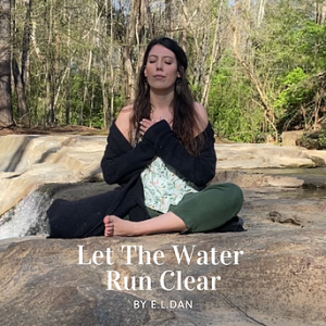 """E.L. Dan, a twentysomething white person with long brown hair sits cross-legged on the ground in an outdoor space, surrounded by trees. She wears green pants, a green floral top, and a black cardigan and has her hands over her chest and her eyes closed. Overlayed at the bottom of the photo is the text """"Let the Water Run Clear by E.L. Dan."""""""